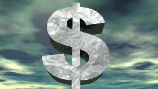 Dollar sign over dark sky