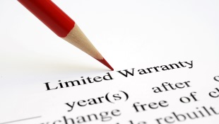 Red Pencil leaning on Limited Warranty document