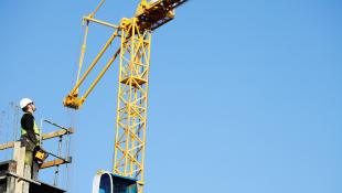 Construction worker on crane