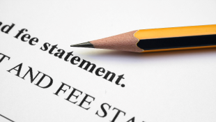 Pencil resting on fee statement