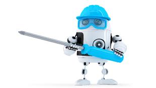 Tiny robot holding screwdriver
