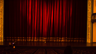 Theater red curtain over stage