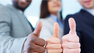 Three businessmembers with thumbs up