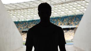 Silhouette man in stadium entrance