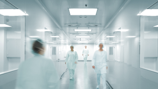 Doctors walking through modern hospital