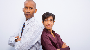 Businessman and woman back to back