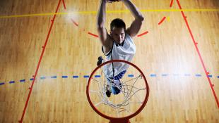 Basketball player shooting basket
