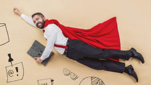 Businessman in superhero flying pose
