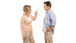 Two elderly people arguing