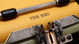 The end printed on paper in typewriter
