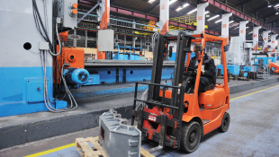 Forklift truck carrying materials