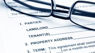 Glasses lying on Residential lease agreement
