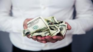 Businessman holding money in hands