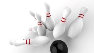 Bowling ball striking pinballs