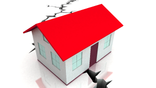 Illustration of house sitting on crack