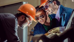 Workers repairing machine