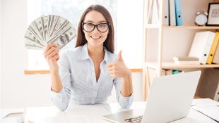 Businesswoman holding up cash