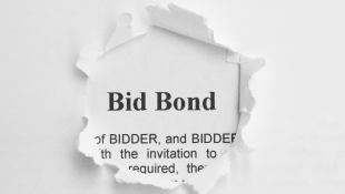 Bid Bond contract peaking through hole in another paper