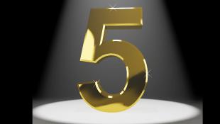 Gold number 5 under spotlight