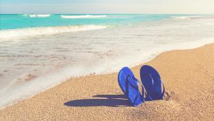 Sandals stuck in beach