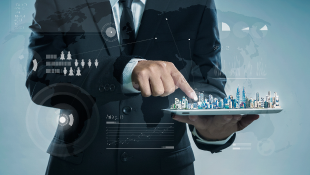 Businessman holding finger on digital skyline model