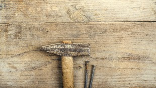 tools on wooden desk background