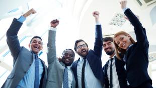 Business team raising arms in triumph