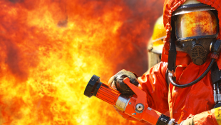 Firefighter with fire in background