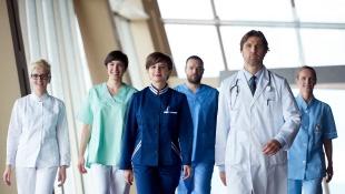 Doctors team walking in hospital corridor