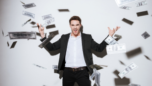Businessman throws money in air