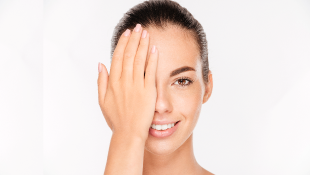 Businesswoman with hand over half of her face