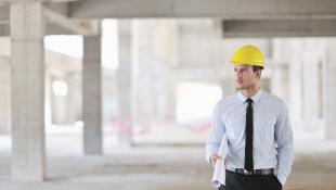 Construction worker walking through site
