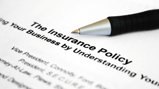 Pen resting on insurance policy