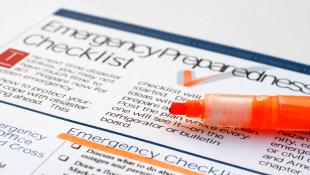 Red pencil on emergency checklist
