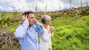 Senior couple distressed by hurricane damage